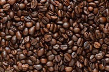 Full frame of aromatic roasted coffee beans background