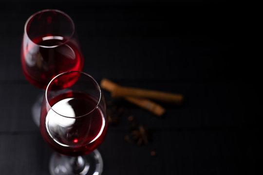Red wine in glass on dark background.