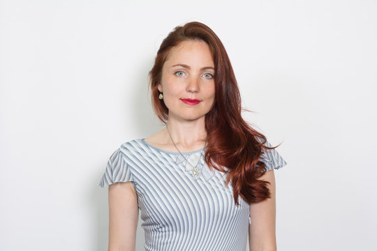 Closeup portrait of a red-haired woman isolated over white background