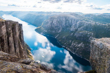 Aerial view of Lysefjorden from Kjeragbolten, with waterfall on the cliff and mountains in background, on the mountain Kjerag in Forsand municipality in Rogaland county, Norway.