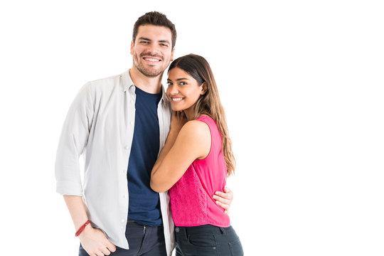 Young Couple Making Eye Contact In Studio