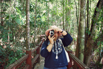 Beautiful Woman taking photo nature in Thailand.