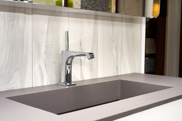 beautiful modern sink and faucet in the interior