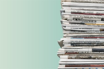 Pile of newspapers on background