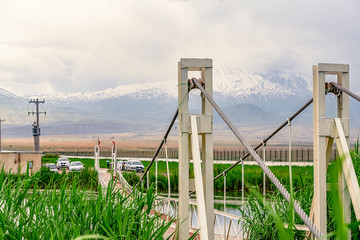 Fabulous View on Cable bridge across Soraya Springsthe witn background of  cloudy Mount Ararat from Iranian side in West Azerbaijan Province