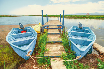 .two wooden boats attached to the pier on the lake at Soraya Springs