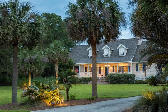 Beautiful southern style house lit up at twilight.