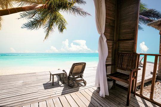 Summer terrac on beach and palms landscape