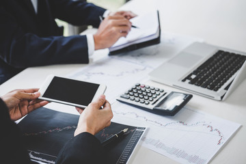 Business team investment working with computer and analysis graph stock market trading with stock chart data, business and technology concept