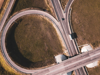 Top down aerial view of a traffic roundabout on a main road