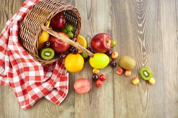 basket of fruits on hard wood surface
