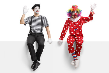 Clown and a mime sitting on a panel and waving