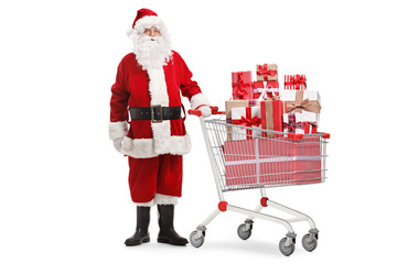 Santa claus standing with presents in a shopping cart