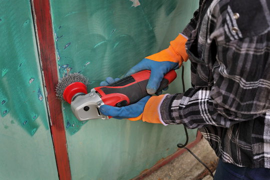 Old metal door repairing, rust and paint cleaning