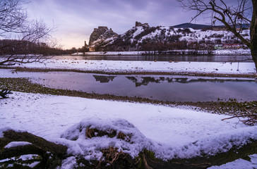 Snow Covered Devin Castle Ruins above the Danube River in Bratislava, Slovakia in the Morning