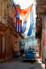 Poster Havana Antique car and cuban flag in Old Havana