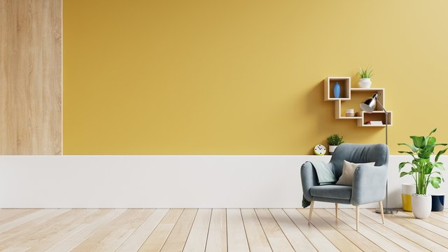 Living room interior with fabric armchair ,lamp,book and plants on empty yellow wall background.3d renderin