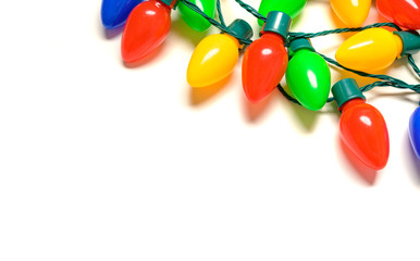 Colorful Christmas lights on a white background
