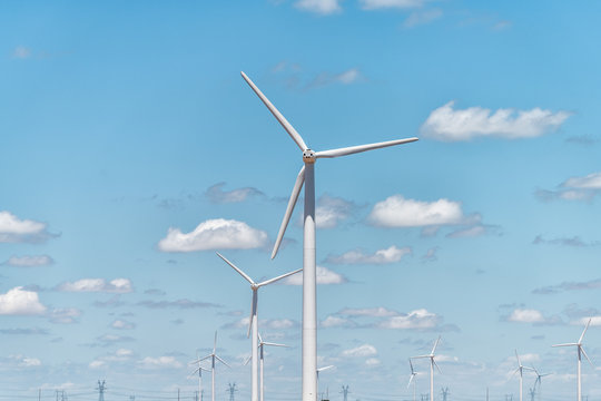 Wind turbine farm closeup near Snyder Roscoe and Sweetwater Texas in USA isolated against sky