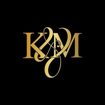 K & M KM logo initial vector mark. Initial letter K & M KM luxury art vector mark logo, gold color on black background.