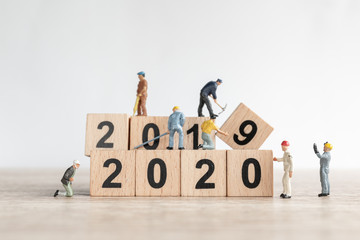 Miniature worker team create number 2020 and remove number 2019  , Happy new year  concept