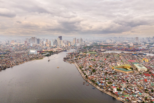 Cityscape Manila. Residential areas and business center in the city, top view. Big port city. The capital of the Philippines.