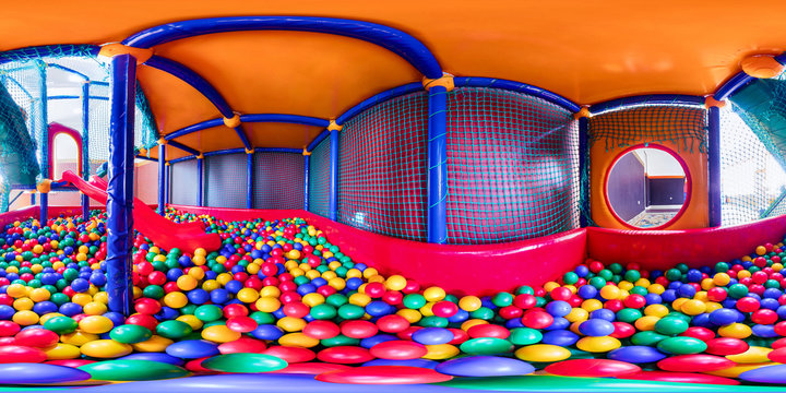 children's playroom with colorful balls and a slide made of plastic. Spherical panorama 360vr