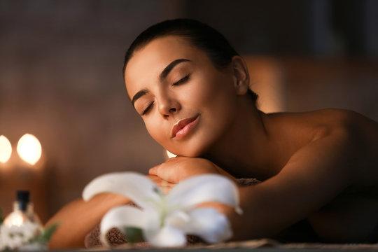 Beautiful young woman relaxing in spa salon
