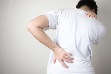 Back pain. Women with back pain, isolated on a white background.