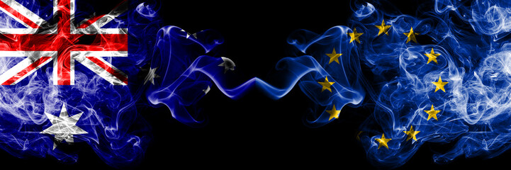 Australia vs European Union, EU smoky mystic flags placed side by side. Thick colored silky smokes combination of national flags of Australia and European Union, EU