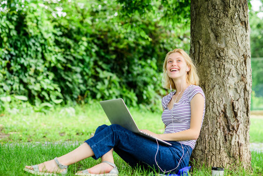 Work in summer park. Girl work with laptop in park. Reasons why you should take your work outside. Nature is essential to wellbeing and ability to be productive and high functioning at work