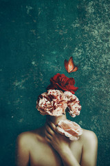 Strange fine art concept. The body of a woman and a bouquet of flowers and butterfly. Image