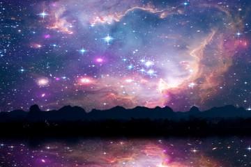 blur reflection galaxy nebula back on night cloud sunset sky silhouette of tree