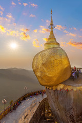 Dramatic picture of the golden rock pilgrimage site in Myanmar Burma.  Held in place by a hair of the Buddha.