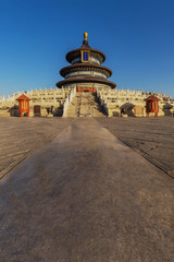 The Temple of Heaven in Beijing China at sunrise with no people and a blue sky