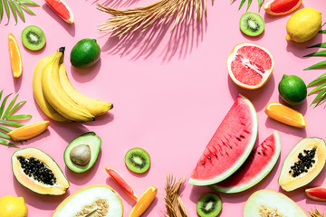 Summer tropical fruits background with strong contrast sunny shadow