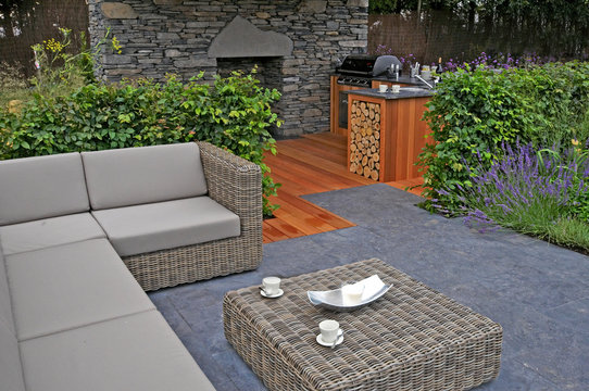 A lifestyle garden combining outdoor kitchen and indoor living in style and comfort