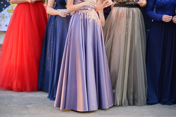 Young girls in long evening dresses, the lower part
