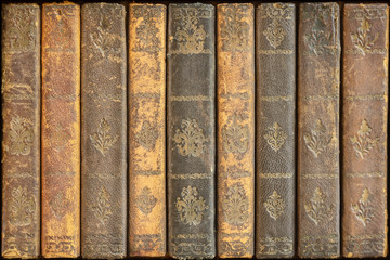 Row of ancient medieval weathered books