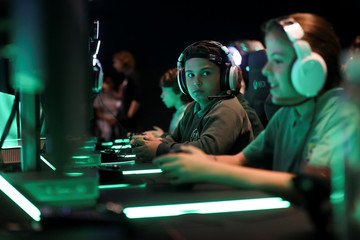 Young gamers play Xbox at Microsoft's new Oxford Circus store ahead of its opening in London