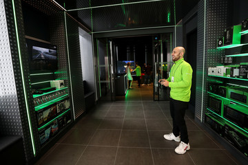 An employee plays an Xbox game inside Microsoft's new Oxford Circus store ahead of its opening in London