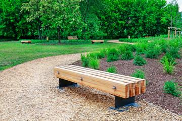 Modern wooden bench in city park
