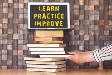 Learn Practice Improve Concept on laptop
