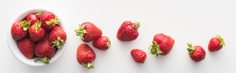 panoramic shot of fresh and ripe strawberries on white bowl