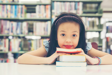 Smiling Kids asian beautiful girl reading books for education and go to school in library. Education and Lifestyle Concept
