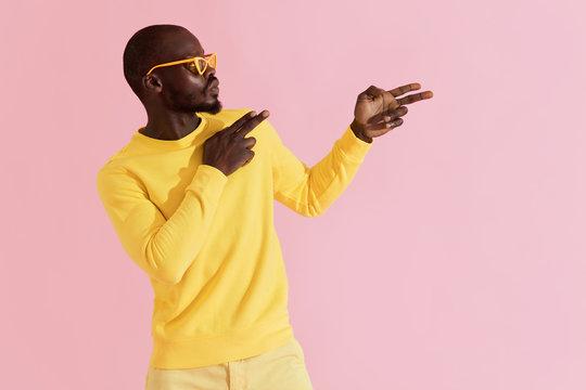 Fashion. Black man in stylish sunglasses and clothes portrait