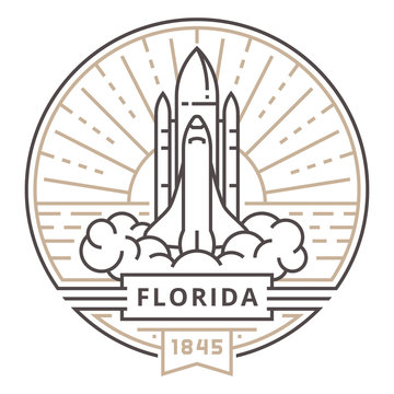 Linear rocket takes off in the state of Florida on the background of the sun in the form of the emblem