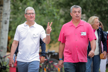 Tim Cook and Eddy Cue attend the annual Allen and Co. Sun Valley media conference in Sun Valley, Idaho