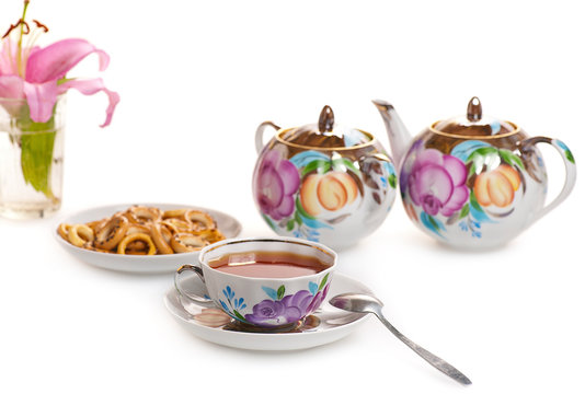floral tea set with pink lily flower on white background