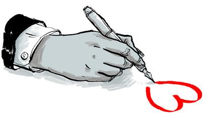 Hand schreibt aus Liebe ein rotes Herz auf Papier